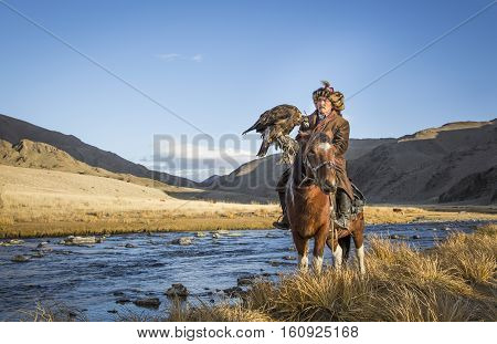 Mongolian Nomad Eagle Hunter On His Hotse