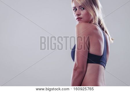 Sport training gym and lifestyle concept. Woman in sporstwear black bra doing fitness exercises