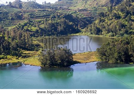 The Color Lake. This Lake is appropriately named Telaga Warna due to a natural phenomenon that causes the water of the lake to change in fluctuating colors. At times it is green, yellow, purple or even taking the colors of the rainbow. This phenomenon occ