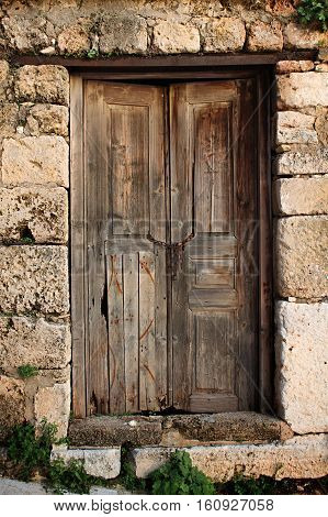 A traditional Lebanese, weathered, wooden door .