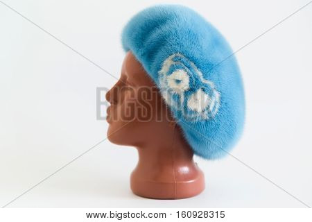 light blue beret from natural mink on a mannequin.