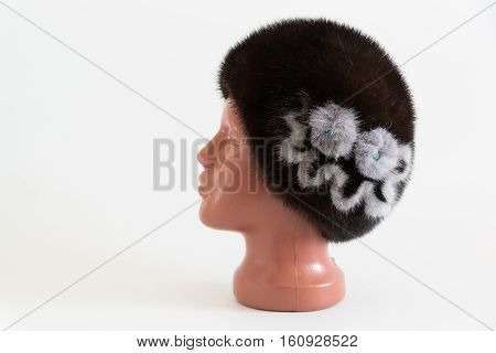 brown beret from natural mink on a mannequin