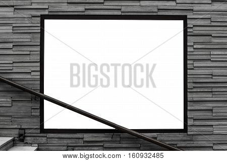 Blank advertising billboard on bricks slate street wall, with handrail and concrete stair steps