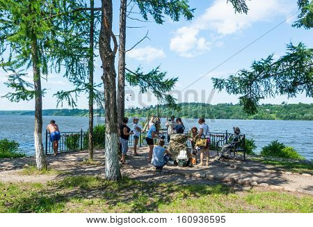 The city of ples Ivanovo region Russia - July 4 2015: Tourists have their photos taken on the observation deck on the Volga river July 4 2015 ples Ivanovo region Russia.