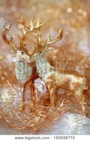 Christmas card.Two golden deer on a New Year's background .