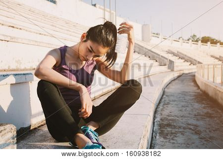 Woman Relaxing After Sports And Drinking Water
