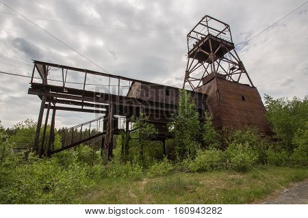 Old abandoned gold ore mine shaft with transporter