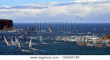 Sydney Australia - December 26 2013. Leader yacht Wild Oats and other Participant Yachts approaching Tasman Sea. Sydney to Hobart Yacht Race on Boxing day.