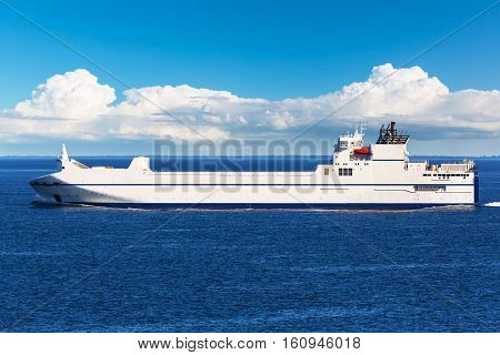 Creative abstract maritime transportation shipping and logistics business trading commerce concept: big industrial freight and cargo container commercial tanker ship vessel in blue ocean or sea water