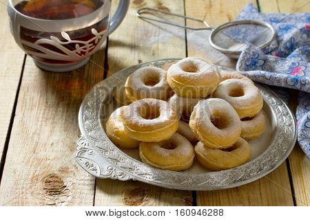 Donuts With Powdered Sugar On A Wooden Background. The Concept Of Celebrating Chanukah, Traditional