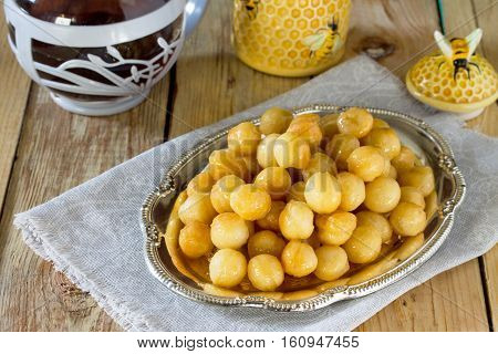 Loukoumades Donuts With Honey And Cinnamon. The Concept Of Celebrating Chanukah, Traditional Jewish