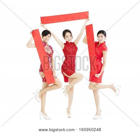 happy girls showing Spring festival couplets for chinese new year