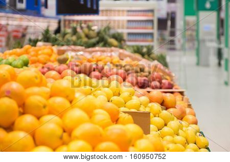 Close up view of fresh fruits on the shelf in the supermarket