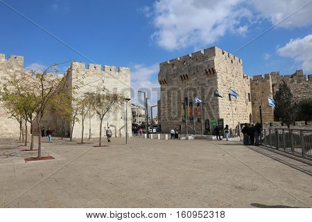 Jerusalem, Israel - November 2, 2016: The Jaffa Gate outside the old city Wall of Jerusalem, a popular place for Tourists and Local People. Israel