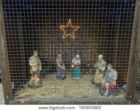Nativity Scene depicting Mary and Joseph in the barn with baby Jesus and the guiding star above