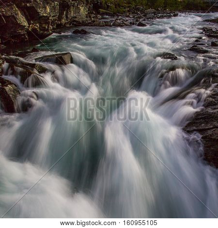 Natural wild river stream in the mountains
