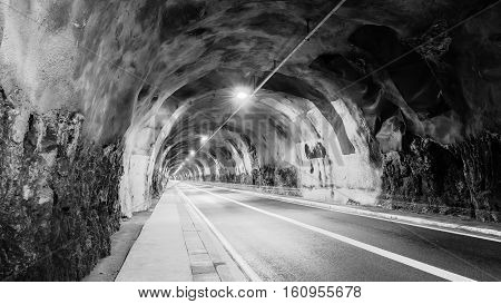Тunnel stretching into the distance. Diminishing perspective. Black and White.