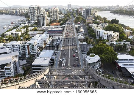 BRISBANE, AUSTRALIA - December 5 2016: Traffic passing under the southern side of Brisbane Story Bridge with view of Kangaroo Point and Captain Burke Park. close up.