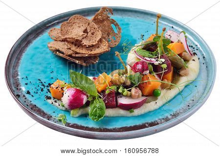 Modern venegret with capers bread crisps pumpkin and pear. The work of the chef on the road plate
