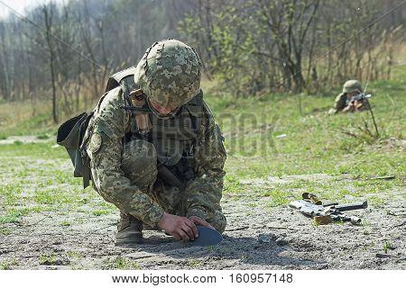 ZHYTOMYR, UKRAINE - April 08, 2016: Military soldiers at tactical exercises near Zhytomyr, Ukraine on September 23, 2013.
