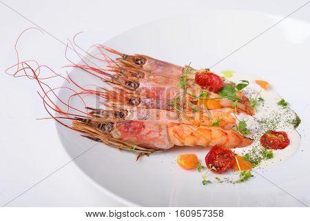 langoustine prawns grilled pink color white background