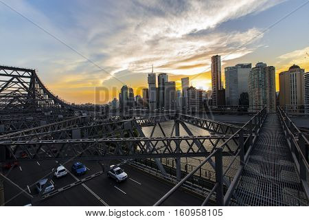 BRISBANE, AUSTRALIA - December 5 2016: Brisbane Story Bridge architecture and walkway across the bridge, with a colourful sunset over Brisbane City