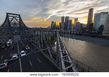 BRISBANE, AUSTRALIA - December 5 2016: Brisbane Story Bridge architecture and traffic with a colourful sunset over Brisbane City.