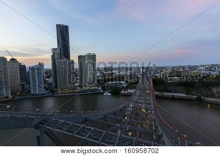 BRISBANE, AUSTRALIA - December 5 2016: Colourful sunset looking down at the night traffic, from the top of Brisbane Story Bridge