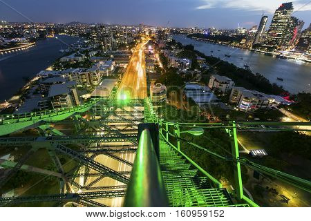 Night traffic trails passing under Brisbane Story Bridge