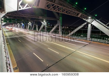 Night traffic trails passing through the southern side of Brisbane Story Bridge.