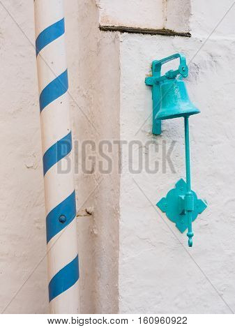 Bell and striped pole near the Battery Portmeirion Wales