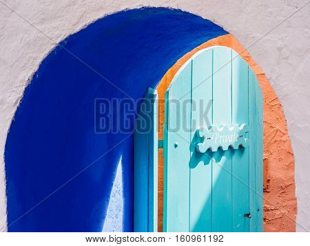 Blue archway and Private sign at the Battery Portmeirion Wales