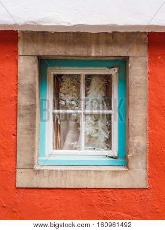 Colourful wall and window frame in one of Portmeirion's cottages.