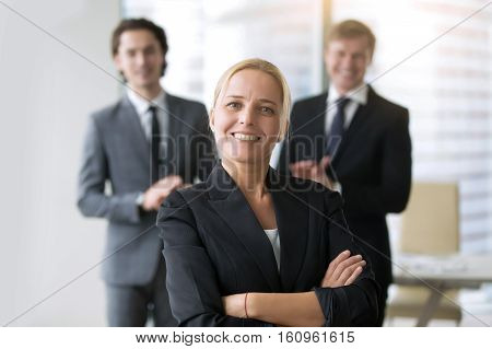 Group of business people, congratulating woman, business advisory services, global ambitions, portrait of smiling female founder, inspiring true story of most successful startup, interview finalist