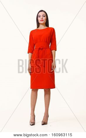 slavic business executive woman streight hair style in red dress full body photo high-heeled shoes isolated on white