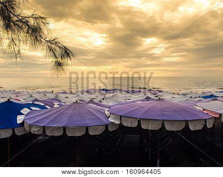 Many Large umbrella crowded along Cha-Am beach