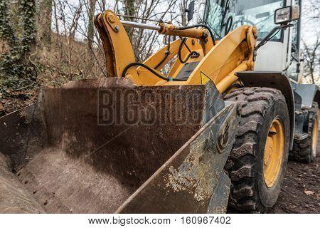 image Metal bucket bulldozer closeup autumn day