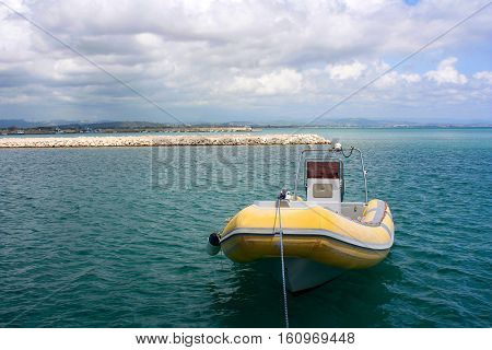 Yellow boat in the port of Katakolon in Greece in a sunny day.