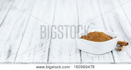 Portion Of Cinnamon Powder On Wooden Background (selective Focus)