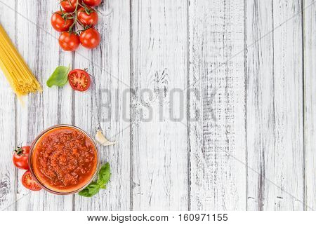 Wooden Table With Tomato Sauce (selective Focus)