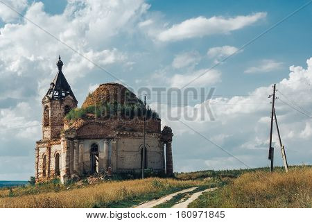 destroyed, ruined, abandoned church or manor, mansion in Russian village
