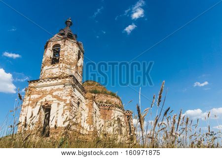 Abandoned ruins of brick Church in field or mansion, manor or ancient castle