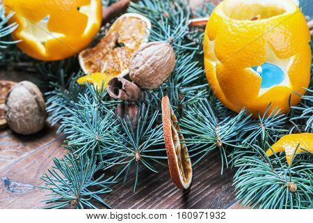 Oranges pierced with cloves, Christmas spices and nuts. Christmas decorations.