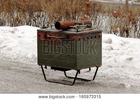 military soldier hunting metal stationary kitchen for preparing outdoor meals