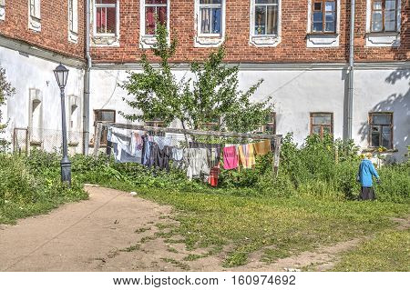 The territory of the Valaam Transfiguration Monastery. Washerwoman clean clothes hung out to dry