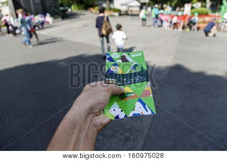 TOKYO, JAPAN - OCTOBER 12, 2016: Man holding ticket from Ueno zoo in Tokyo Japan. It is Japan oldest zoo opened on March 20 1882