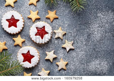Assorted cookies. Christmas Linzer cookies with fir festive decoration with snow. Jelly Linzer cookie star with strawberry jam. Top view. Flat lay. Copy space. Festive decoration.