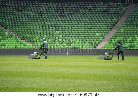 Mowing grass in a football and soccer stadium