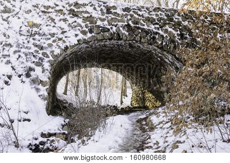 Stream bed under stone bridge culvert in Devil's Hopyard