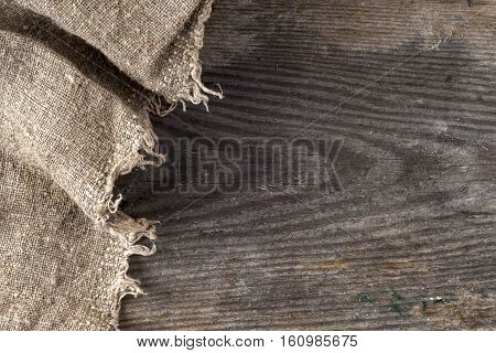 burlap hessian sacking on wooden background. grunge vintage backdrop. Copy space for text.